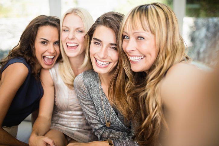 four smiling young women