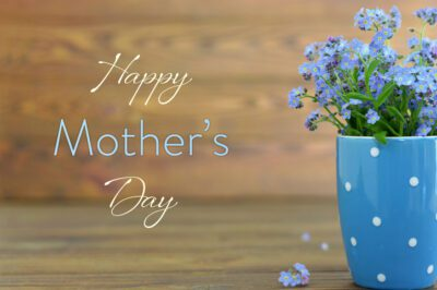 Happy Mothers Day ideas from the Addison Gateway with card, flowers in the cup on wooden background