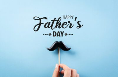 The Addison Gateway shares Happy Father's Day with hand holding black mustache